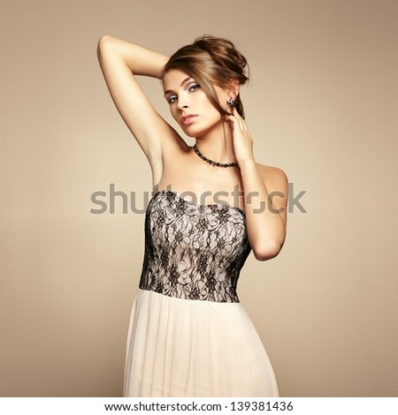 Fashion photo of young beautiful woman. Girl posing. Studio photo - stock photo