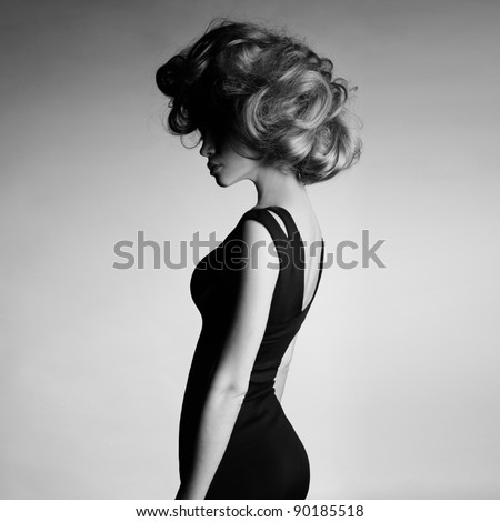 Fashion photo of young lady in elegant black dress #90185518