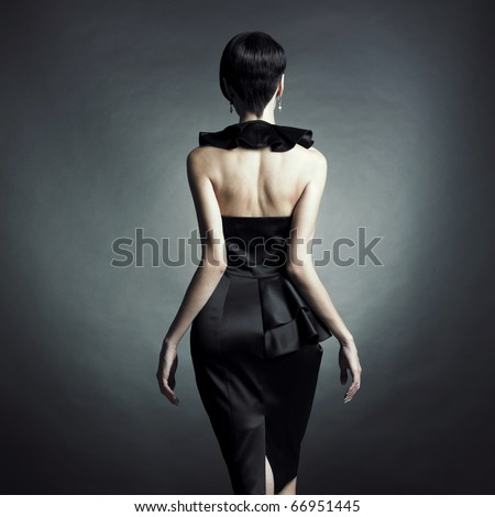 Fashion photo of young lady in elegant evening dress