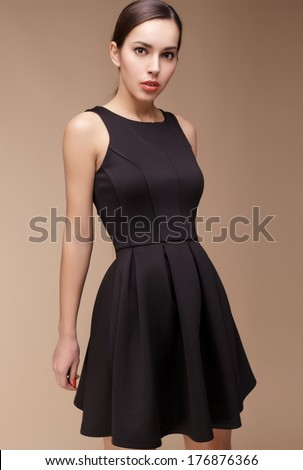 Fashion photo of young magnificent woman in different dress set. Studio photo