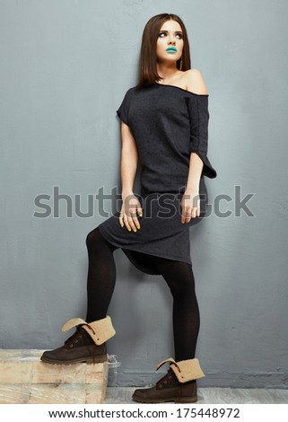 Fashion photo of young model against wall. Dress. #175448972