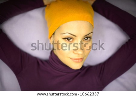 Fashion photo of young woman in orange bandage