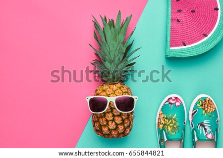 Fashion. Pineapple hipster in sunglasses, stylish sneakers, handbag. Minimal concept, summer accessories, tropical pineapple. Creative art fashionable concept, summertime