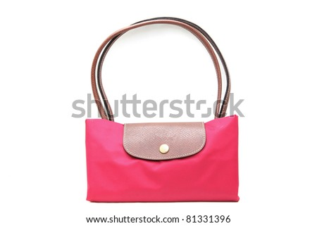 fashion pink fake leather woman bag on white background