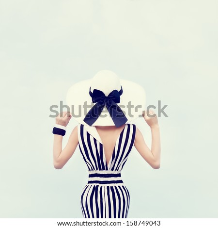 Stock Photo Fashion portrait of a beautiful girl on vacation