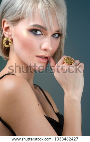 Fashion portrait of a beautiful  woman in stylish. Stylish hairstyle and light makeup.
