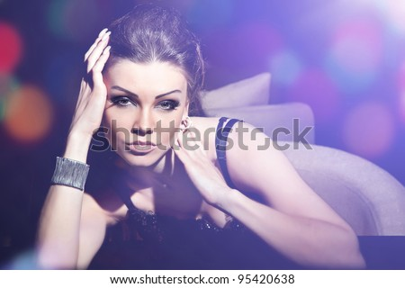 Fashion portrait of a beautiful woman with make-up