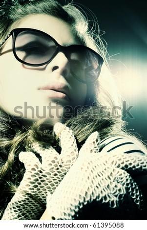 Fashion portrait of a beautiful young sexy woman  wearing sunglasses