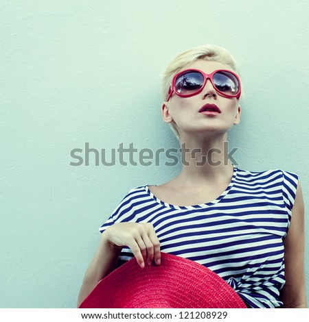 fashion portrait of a girl at a wall