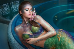 Fashion portrait of a girl in a mermaid costume at a spa.