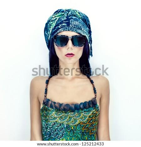 fashion portrait of a girl in a stylish scarf
