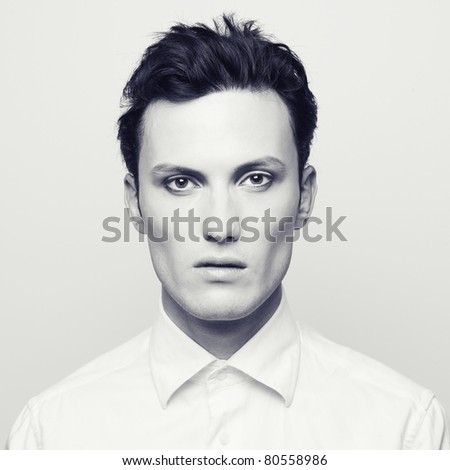 Fashion portrait of a handsome young man with make-up