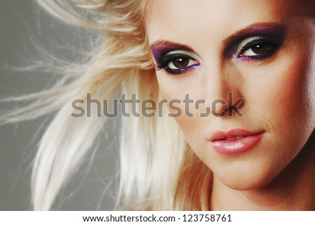 fashion portrait of a woman on a gray background