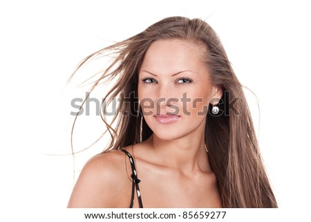 Fashion portrait of a young and sexy beautiful woman with beautiful long hair