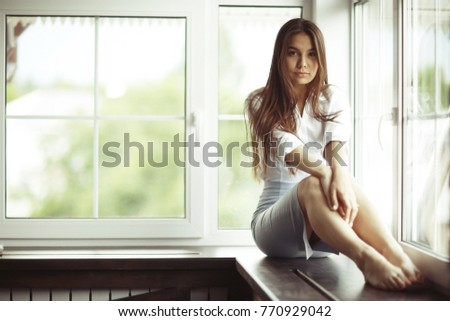 Fashion portrait of a young beautiful adult brunette girl #770929042