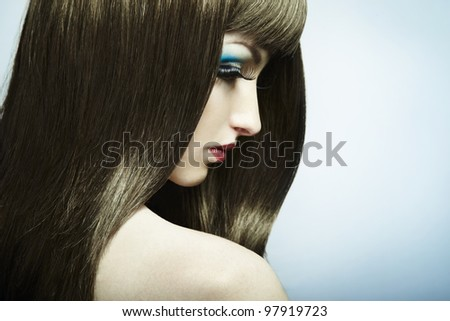 Fashion portrait of a young beautiful dark-haired woman. Close-up