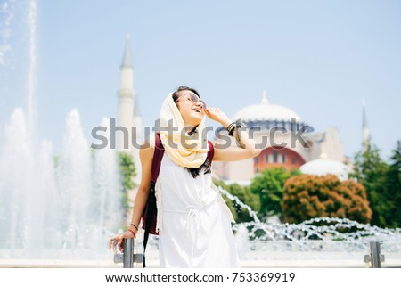 Fashion portrait of a young modern girl on summer vacation. Travel to Turkey #753369919