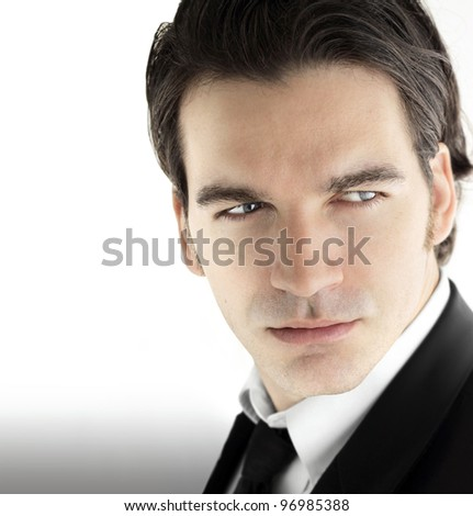 Fashion portrait of a young sexy male model in business wear against bright modern background