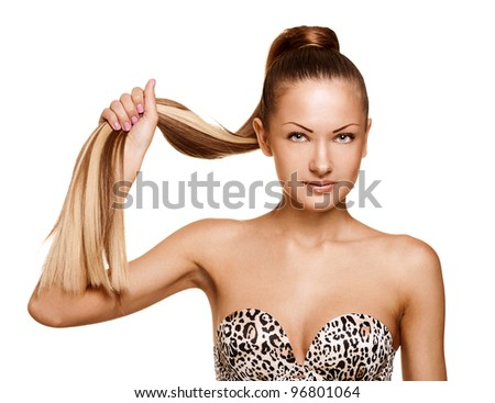 fashion portrait of a young woman holding her long straight healthy hair