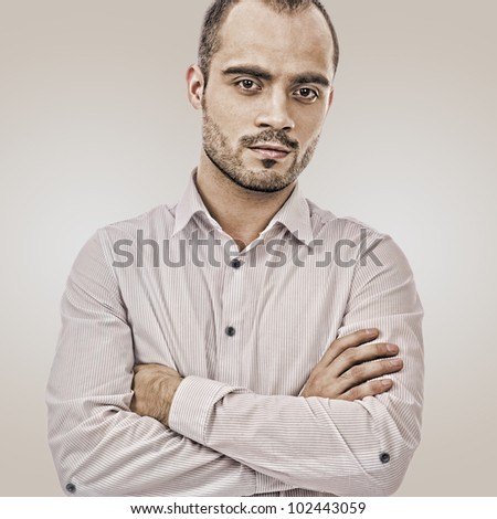 Fashion portrait of adult handsome business man looking at camera