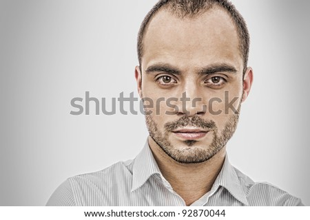 Fashion portrait of adult handsome business man looking at camera - stock photo