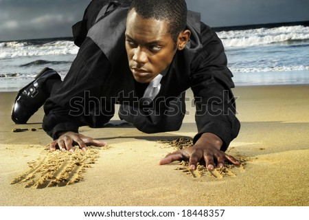 Fashion portrait of an attractive male model crawling on the beach
