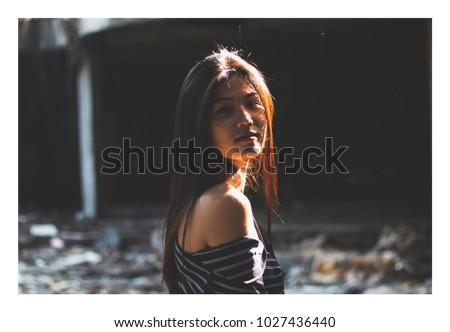 Fashion Portrait of asian woman. Tones like film tone. Photo have a frame #1027436440