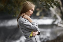 Fashion portrait of beautiful blonde woman in stylish clothes outdoor in autumn.