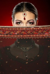 Fashion portrait of beautiful female wearing traditional indian costume