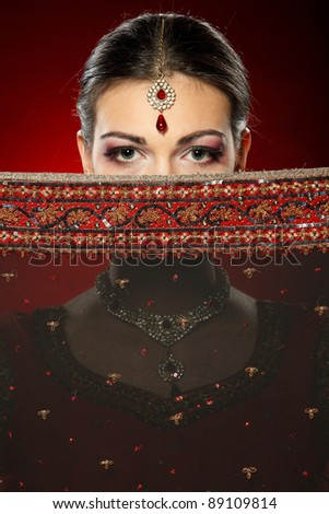 Fashion portrait of beautiful female wearing traditional indian costume