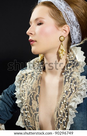 Fashion portrait of beautiful girl with lace ribbon over black background