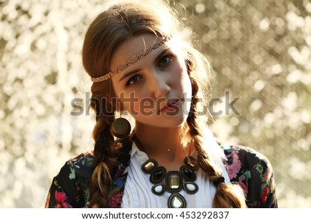 2c28cec0a2f Fashion portrait of beautiful hippie young woman wearing boho chic clothes  outdoors. Soft warm vintage