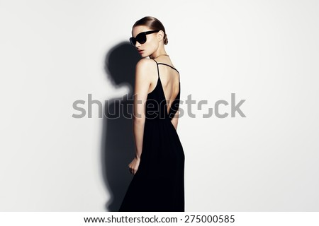 fashion portrait of beautiful model with sunglasses #275000585