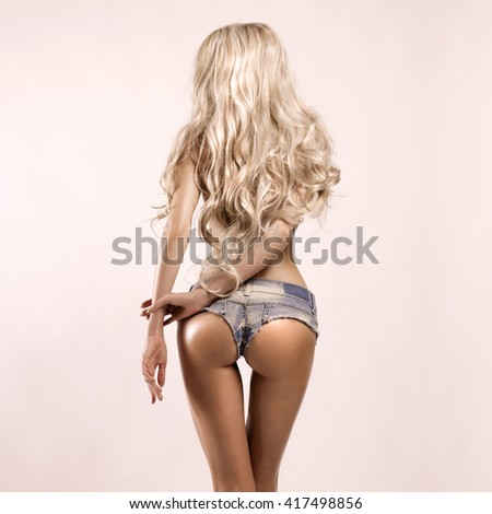 Fashion portrait of beautiful sexy blonde in jeans short