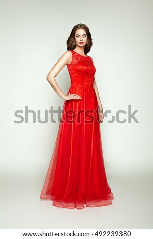 Young Beauty Woman In Fluttering Red Dress White Background Ez