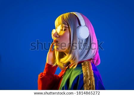 Fashion portrait of beautiful woman on colored background Foto d'archivio ©
