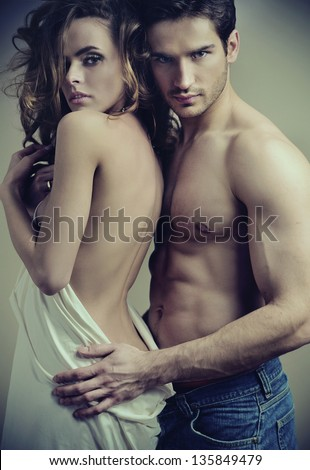 Fashion portrait of beautiful young lovers - stock photo