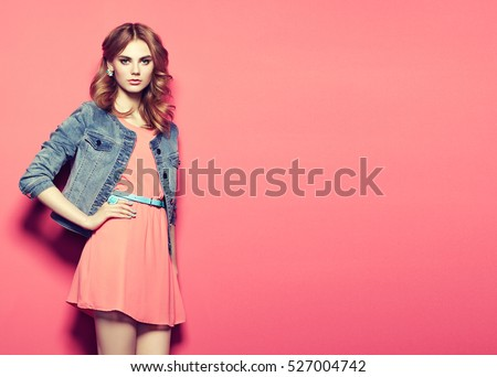 Fashion portrait of beautiful young woman in a summer dress. Beauty spring photo #527004742