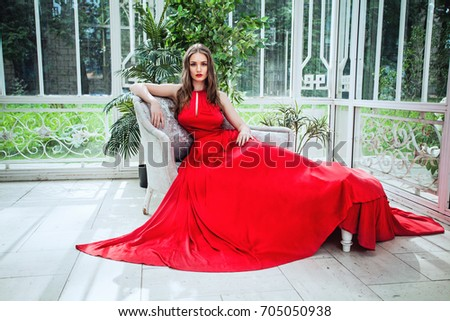 Fashion Portrait of Cute Woman Fashion Model in Red Evening Gown