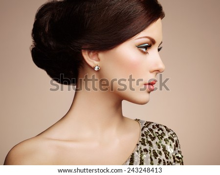 Fashion portrait of elegant woman with magnificent hair. Blonde girl. Perfect make-up #243248413