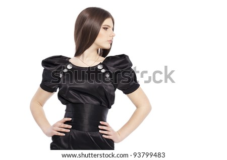 Fashion portrait of luxury young girl teenager in black dress with long glossy healthy brown hairs posing on white background in studio isolated closeup - stock photo