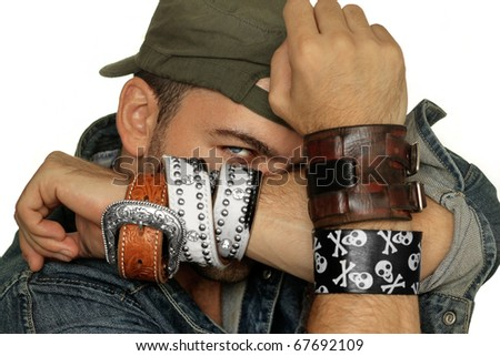 Fashion portrait of male model posing with bracelets backlit against white background