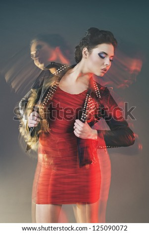 Fashion portrait of one beautiful woman in mixed light