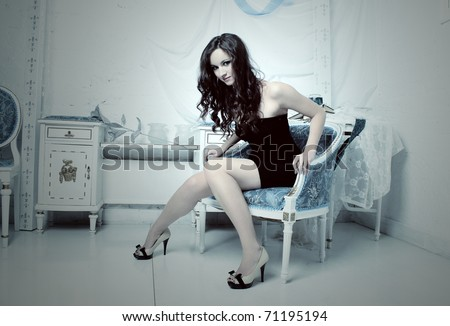 Fashion portrait of pretty young woman with curly hair