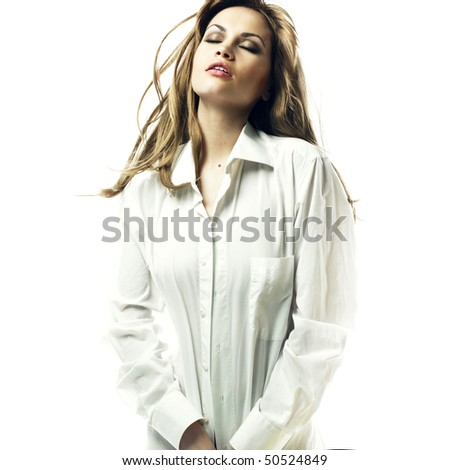 Fashion portrait of sensual blond in man's shirt