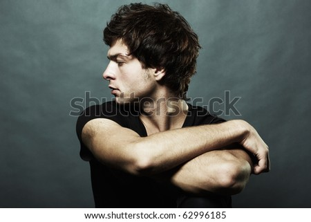 Fashion portrait of the young beautiful man