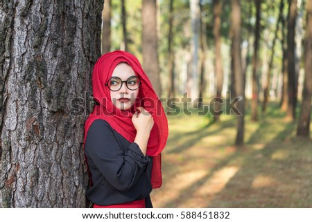 Fashion portrait of young beautiful muslim woman with the red  hijab #588451832