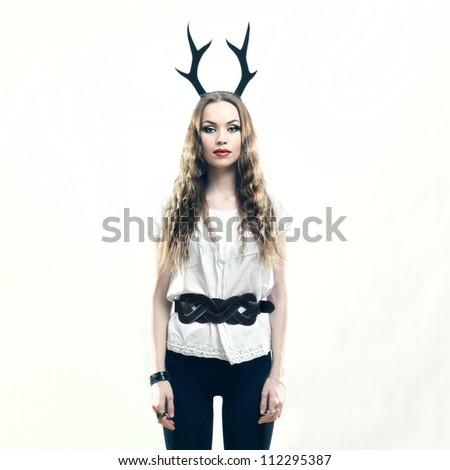 Fashion portrait of young beautiful woman. Deer.
