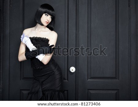 Fashion portrait of young beautiful woman in the black dress #81273406