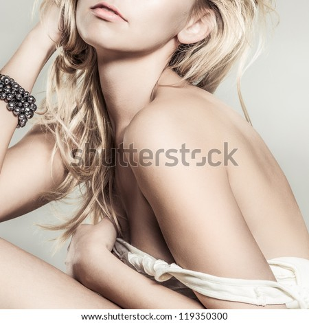 Fashion portrait of young beautiful woman  posing in studio